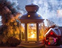 Christmas lantern with burning candle Royalty Free Stock Photos