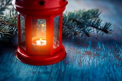 Christmas lantern with a candle and a branch of a Christmas tree royalty free stock photography
