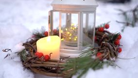 Christmas lantern with candle-. Christmas lantern with candle. It stands in the snow stock footage