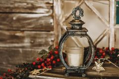Christmas lantern with candle on the table Stock Photo