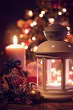 Christmas lantern and candle under the tree. royalty free stock photos