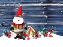 Christmas lantern decoration winter berries and snow on wooden b. Christmas santa lantern fruit berries apple and decoration with fir branches snow Royalty Free Stock Photos