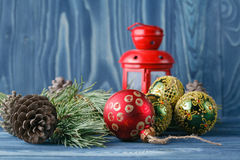 Christmas Lantern with decorations on blue wooden background. St Royalty Free Stock Photo