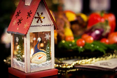 Christmas lantern on a dinner table Royalty Free Stock Image