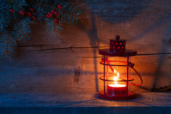 Christmas lantern in dusk on  wooden background. Royalty Free Stock Photo