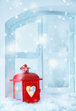 Christmas lantern with falling snow Stock Photo