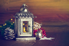 Christmas lantern with fir and tinsel Stock Photos