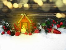 Christmas lantern decoration winter berries and snow on wooden b. Christmas lantern fruit berries apple and decoration with fir branches snow Stock Images