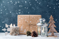 Christmas lantern and gift box. Over dark background. Christmas holiday celebration concept Stock Photo