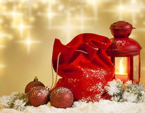 Christmas lantern gifts and baubles on snow Royalty Free Stock Images
