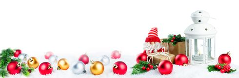 Christmas lantern with gifts, colored balls and Santa Claus on s stock image
