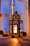 Christmas lantern with glowing candle Stock Photos