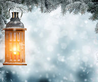 Christmas lantern hanging on fir branches Stock Photo