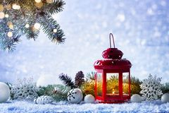 Free Christmas Lantern In Snow With Fir Tree Branch And Holiday Decorations. Winter Cozy Scene Stock Photography - 161056292