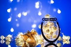 Christmas Lantern with lights garland and decoration bells. Royalty Free Stock Image