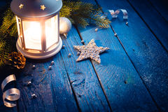 Christmas lantern in night on old wooden background Stock Photography
