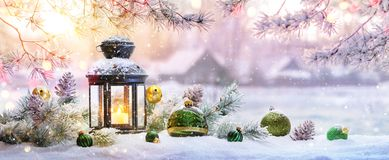 Free Christmas Lantern On Snow With Fir Branch In The Sunlight Royalty Free Stock Images - 159535459