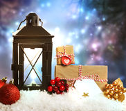 Christmas lantern with ornaments and presents Stock Photography