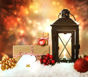 Christmas lantern with ornaments and presents Royalty Free Stock Photo