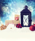 Christmas lantern with ornaments in the snow Stock Images