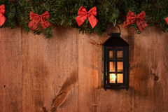 Christmas lantern with pine boughs and bows Stock Photography