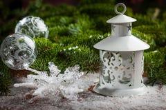 Christmas lantern on snow Royalty Free Stock Image