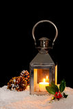 Christmas lantern in the snow. Stock Photo