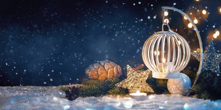 Christmas Lantern On Snow With decorations. New Year`s card royalty free stock image