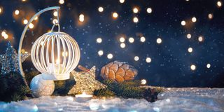 Christmas Lantern On Snow With Fir Branch In Evening Scene stock images