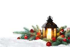 Christmas Lantern On Snow With Fir Branch isolated on white background - Winter Decoration Background royalty free stock photos