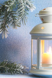 Christmas lantern with snow and tree abstract background. Closeup Royalty Free Stock Image
