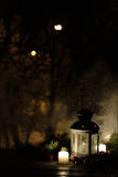 Christmas lantern with snowfall, candles, view from the window on the night street Royalty Free Stock Image