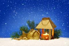 Christmas lantern and snowfall. Royalty Free Stock Image