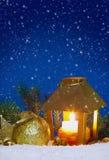Christmas lantern and snowfall. Royalty Free Stock Images