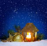 Christmas lantern and snowfall. Stock Photos
