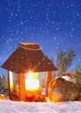 Christmas lantern and snowfall. Stock Photo