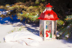 Christmas lantern with snowfall near green fir tree Royalty Free Stock Image