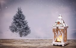 Christmas lantern and snowy firs. In the background Royalty Free Stock Photos