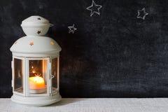 Christmas lantern and stars on blackboard Royalty Free Stock Photos