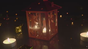 Christmas lantern and tea light candles on blinking bokeh background stock video footage