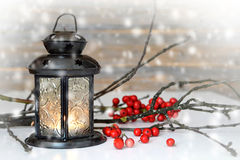 Christmas lantern, twigs and red berries Royalty Free Stock Photography