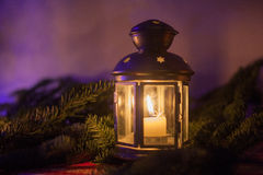 Christmas lantern under the christmas tree Royalty Free Stock Images