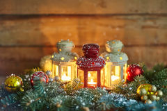 Christmas lanterns and baubles in snow Royalty Free Stock Images