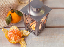 Christmas Lanterns and mandarin on woodboard. Christmas Lanterns and mandarin on wooden background. Close-up Royalty Free Stock Image