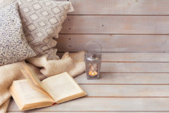 Christmas Lanterns and open book on wooden background. Stock Image