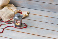 Christmas Lanterns, plaid and red beads on light wooden backgrou Stock Image