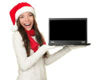 Christmas laptop computer woman excited. Showing monitor screen with copy space. Happy smiling mixed race Chinese Asian / white Caucasian woman wearing santa Stock Images