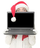 Christmas laptop woman surprised Royalty Free Stock Photo