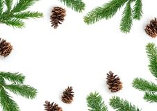 Christmas Layout Composition With Pine Cones and Fir Branches. Merry Christmas layout composition, top view with fir tree branches and pine cones on a white Royalty Free Stock Photography
