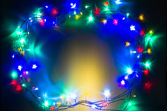 Christmas LED Lights Frame. Frame made with Christmas tree colorful LED lights on White background Royalty Free Stock Images